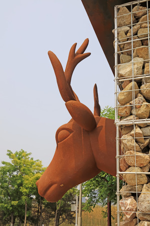 Animal statues in a park, closeup of photo