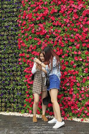 tangshan city: Tangshan city - April 29: Shoot their own girl in a garden, April 29, 2016, Tangshan city, china Editorial