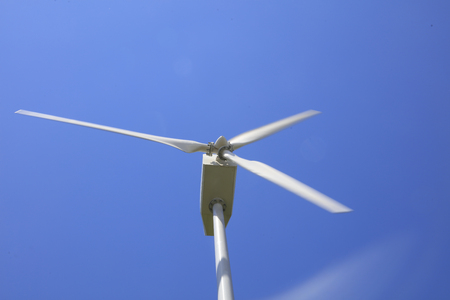 driven: wind driven generator under blue sky Stock Photo