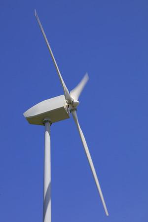 wind driven generator under blue sky Stock Photo