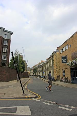 cambridge: Cambridge - October 3: Tourists walking in the street on October 3, 2015, Cambridge, UK.