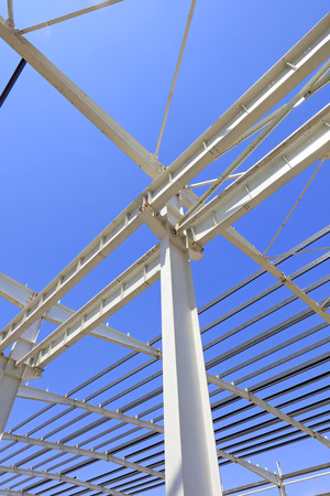 steel girder: steel girder truss under blue sky, closeup of photo