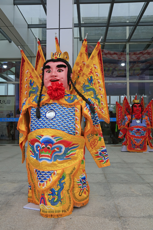 masculinity: chinese drama character sculpture, closeup of photo