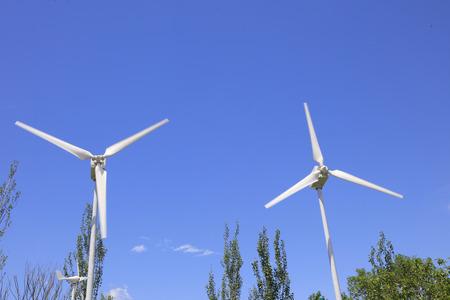impeller: wind driven generator under blue sky Stock Photo