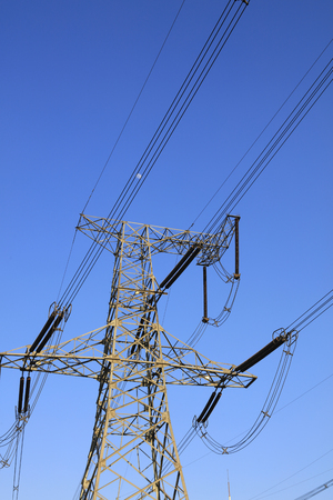 Electric power tower in blue sky Stock Photo
