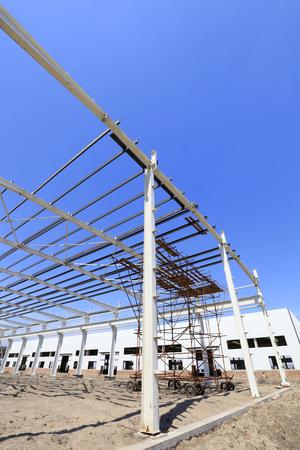 truss: steel girder truss under blue sky, closeup of photo
