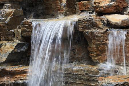 fake: Fake rock waterfall, closeup of photo Stock Photo