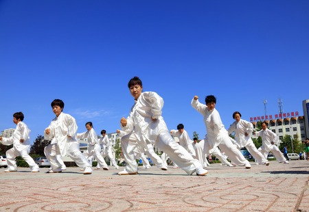 tangshan city: Tangshan - August 8: Chinese Kungfu-Tai Chi exercise in the park, August 8, 2016, tangshan city, hebei province, China Editorial