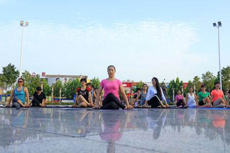 tangshan city: Tangshan - August 8: women doing yoga exercise in the park, August 8, 2016, tangshan city, hebei province, China