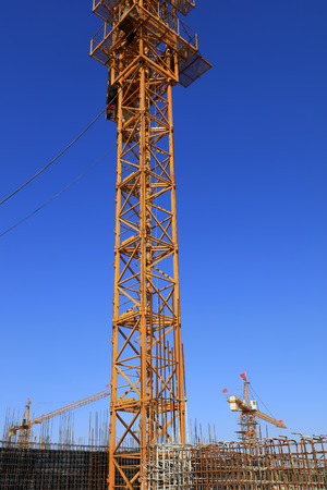 bracket of tower crane in the blue sky background