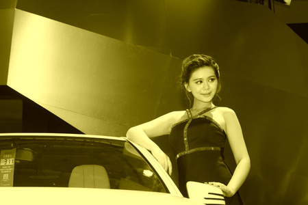 hebei: TANGSHAN - MAY 31: Beauty model in a car markets on may 31, 2014, Tangshan city, Hebei Province, China Editorial