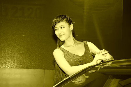 TANGSHAN - MAY 31: Beauty model in a car markets on may 31, 2014, Tangshan city, Hebei Province, China Editorial