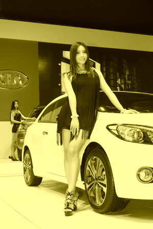 arms trade: TANGSHAN - MAY 31: Beauty model in a car markets on may 31, 2014, Tangshan city, Hebei Province, China Editorial