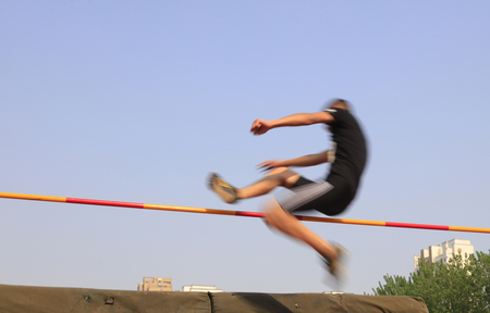men high jump athletes in the playground Stock Photo