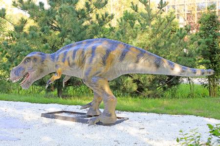 Dinosaur sculpture in a park