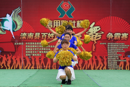 hebei: Luannan County - June 17: fitness dance performances in the square, on June 17, 2015, luannan county, hebei province, China