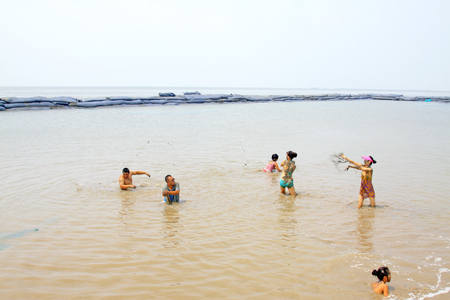 Luannan - July 31: visitors taking bath in the muddy tidal flats, on July 31, 2015, luannan county, hebei province, China