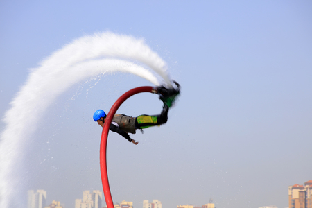 acrobatics: Water stunts performance in a park