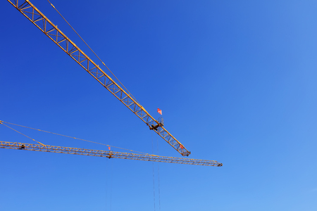 Tower crane arm in the blue sky background Stock Photo