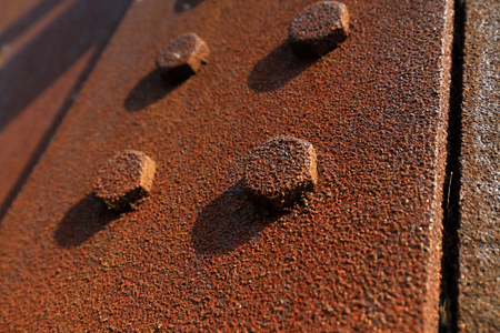 rivets: oxidized rusty steel plate and rivet