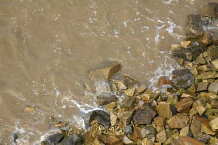 berm: Rocks in the water