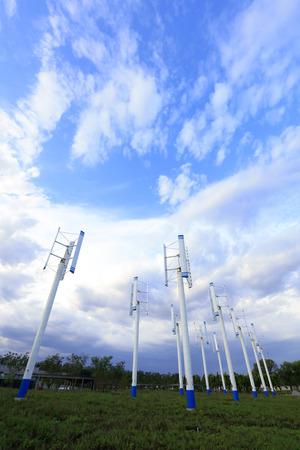 vertical axis wind turbine under blue sky Stock Photo