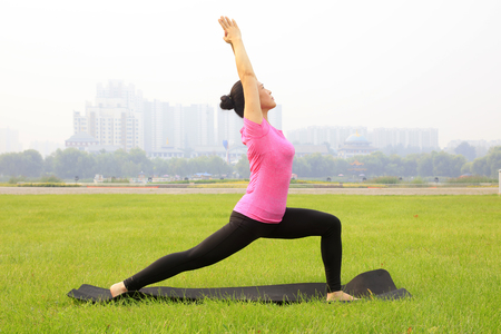 Tangshan City - September 4: women doing yoga exercise in the park, on September 4, 2016, tangshan city, hebei province, China. Editorial