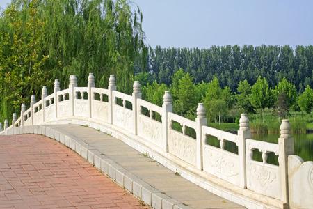 white marble stone bridge