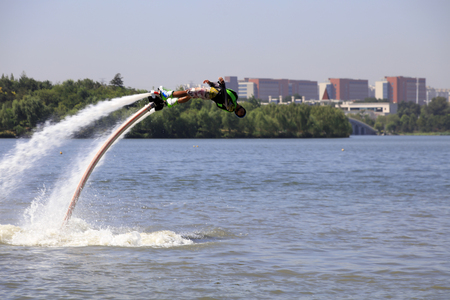 Water stunts performance in a park