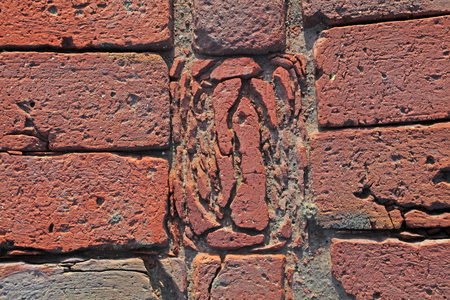 Red brick impregnated by salt water for a long time  Imagens