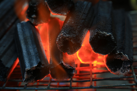 Burning charcoal, closeup of photo