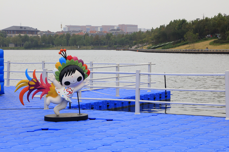 Flower Fairy sculpture on the deck of plastic float, Tangshan, China.