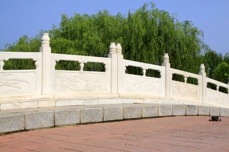 white marble stone bridge