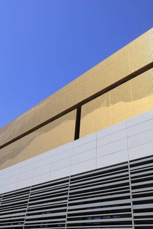 Yellow metal exterior wall decoration