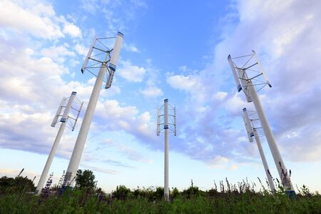 vertical axis wind turbine under blue sky Stock Photo