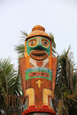 Wood totem poles in a park, China