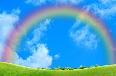 Beautiful green grass against blue sky and rainbow