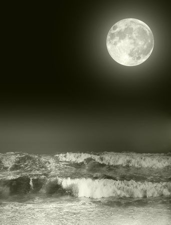 Full moon over night ocean photo