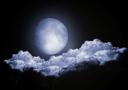 moon stars: full moon in clouds Stock Photo