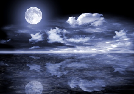 The full moon in clouds over water photo