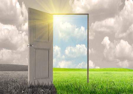 Sun rays and open door Stock Photo