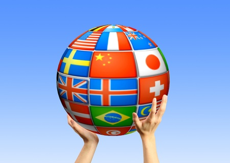 Human hands holding a sphere from flags Stock Photo - 11532720