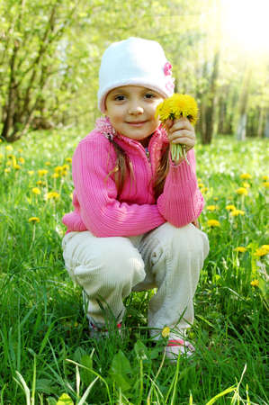 The little girl among dandelions photo