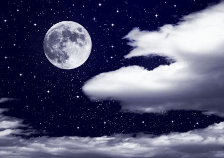 full moon in clouds Фото со стока