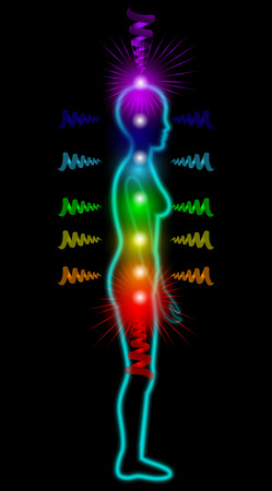 energy healing: Woman silhouette on the black background with shining chakras