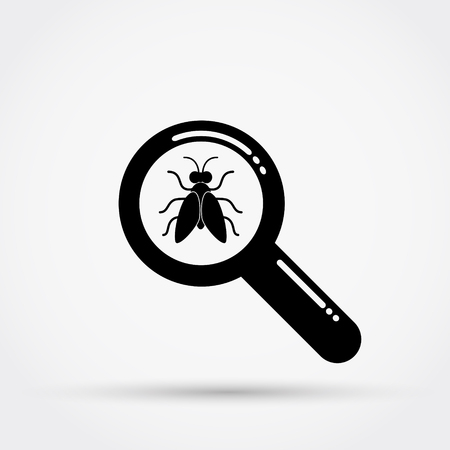 Magnifying glass and fly.
