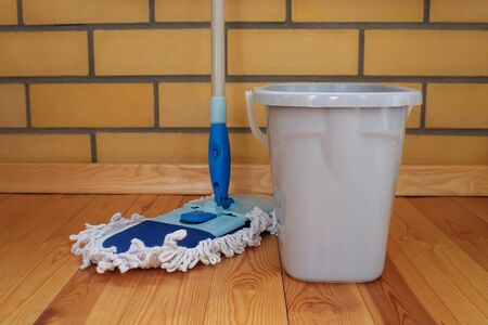 Cleaning equipment. A bucket of water and mop. Wash wood floor concept