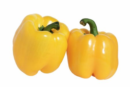 Two large yellow pepper isolated on a white background. photo