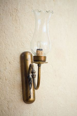 sconces: On the wall hangs a decorative lamp with a glass bulb. Stock Photo