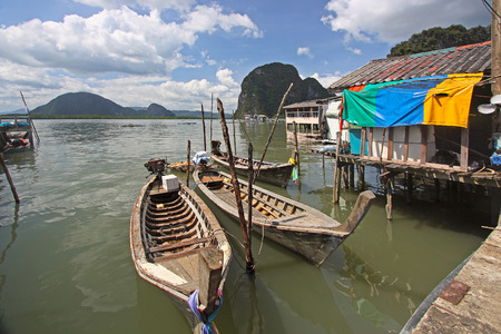 fishing village: View of the fishing village, boats near the houses on stilts, Thailand.
